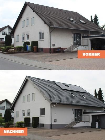 Neue Dacheindeckung mit schwarzen Ziegeln